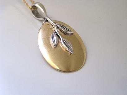 Sterling Silver Leaf On Oval Gold Necklace by SimonDesigns on Etsy from etsy.com