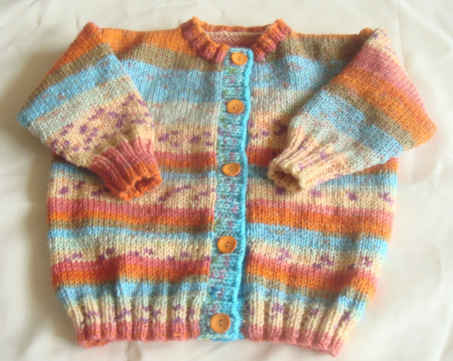 Multi coloured jacket aged approx 1 year. From grandmalovestooknit