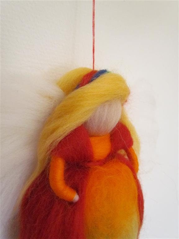 Sweet Rainbow  angel from wool in red/orange/yellow/green/blue and purple waldorf way made