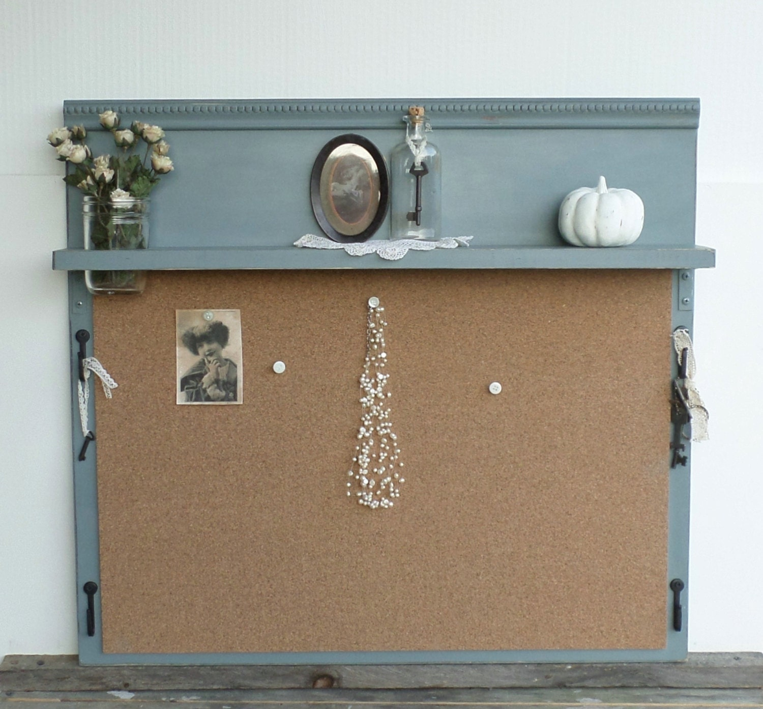 Unavailable listing on etsy for Cork board with hooks