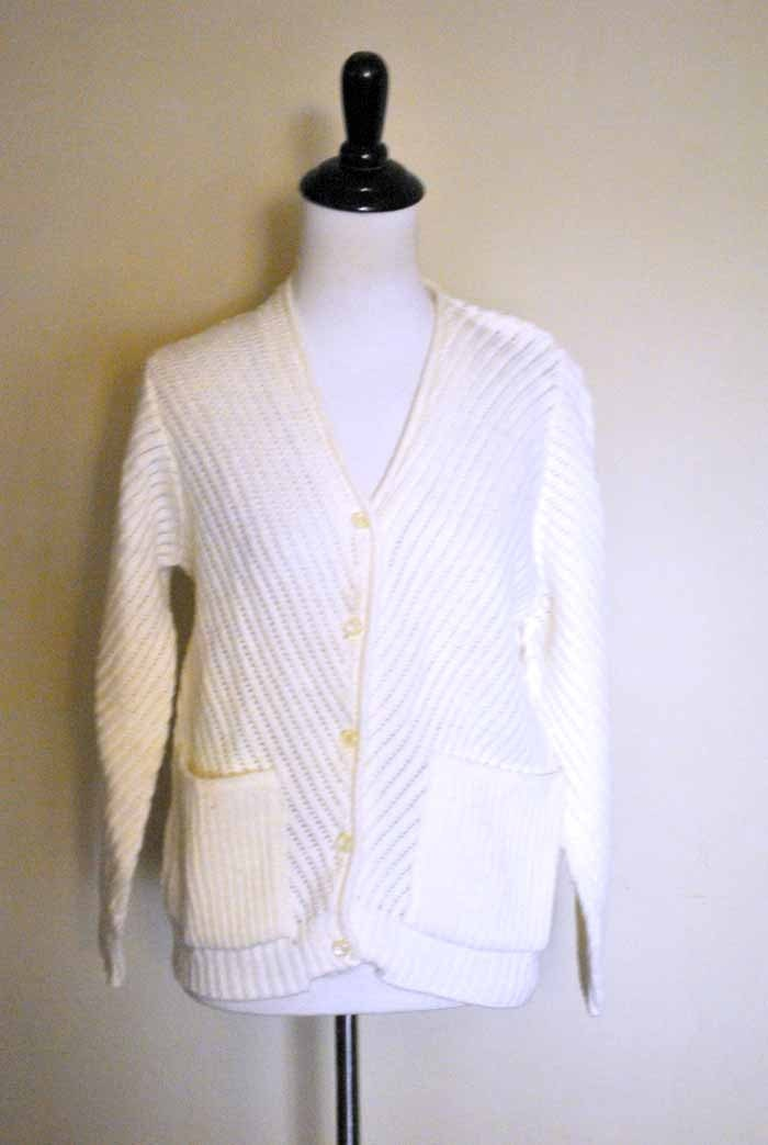 Women, consider throwing on an oversized cowl-neck sweater with a pair of slim black trousers. Or, for a posh addition to an all black outfit, look for a cream cardigan or shrug sweater with a visually stunning texture, such as angora. Pop the sweater over a black dress or black blouse and trousers, and add black dress shoes for a strong finish.