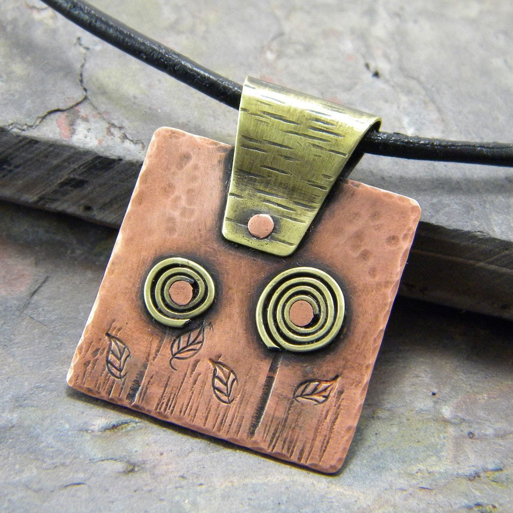 necklace. whimsical brass flowers, copper square pendant, black leather cord