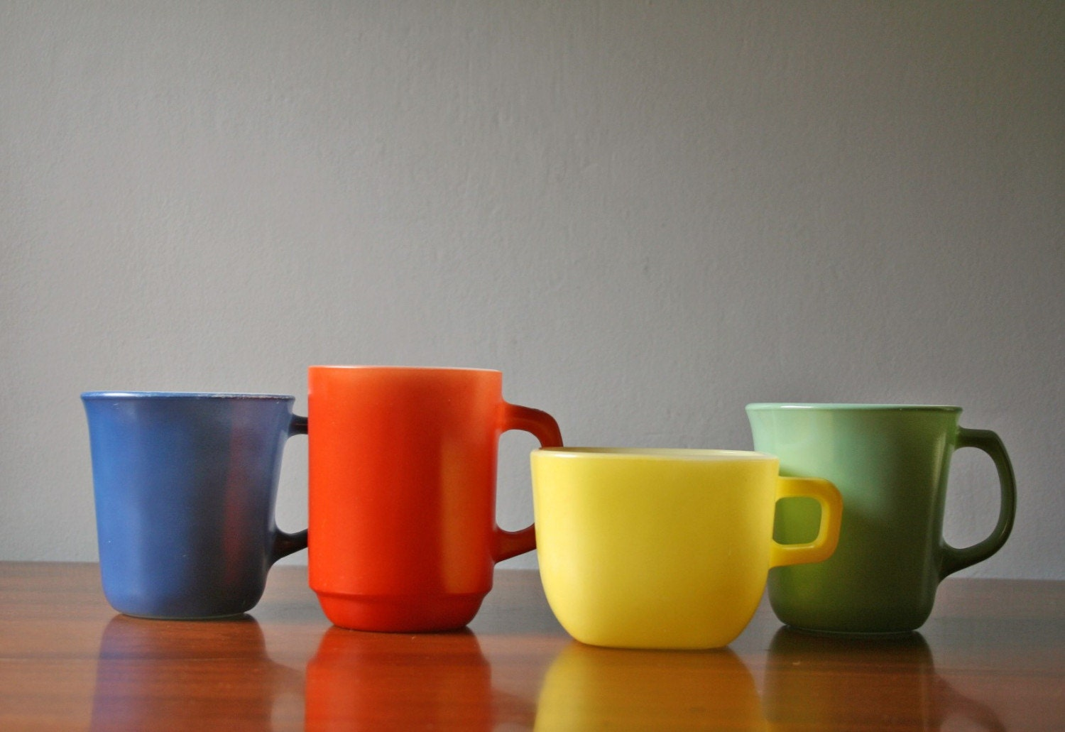 four mix and match colored milkglass coffee mugs