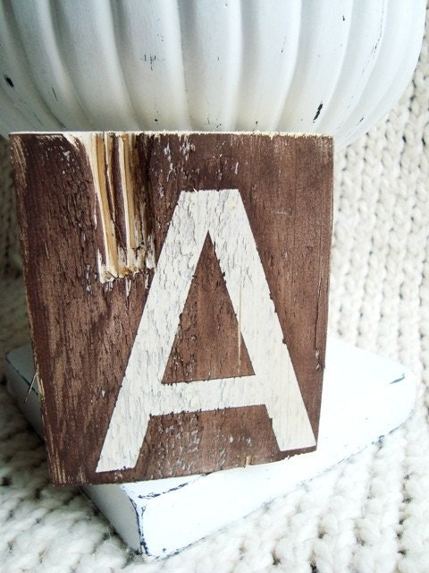 Letter A on distressed wood in White and Brown