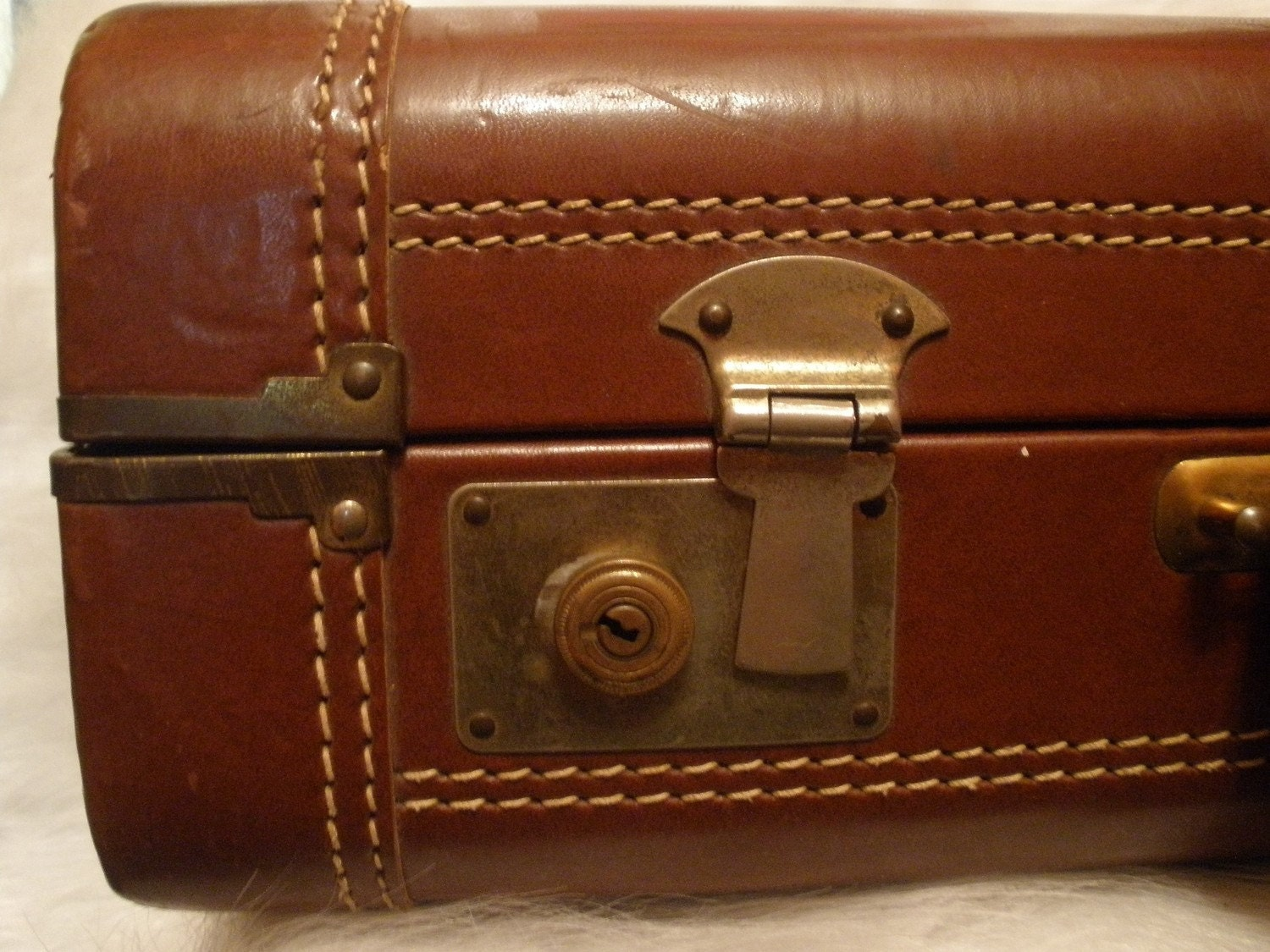 ZEPHYRLYTE BROWN LEATHER suitcase