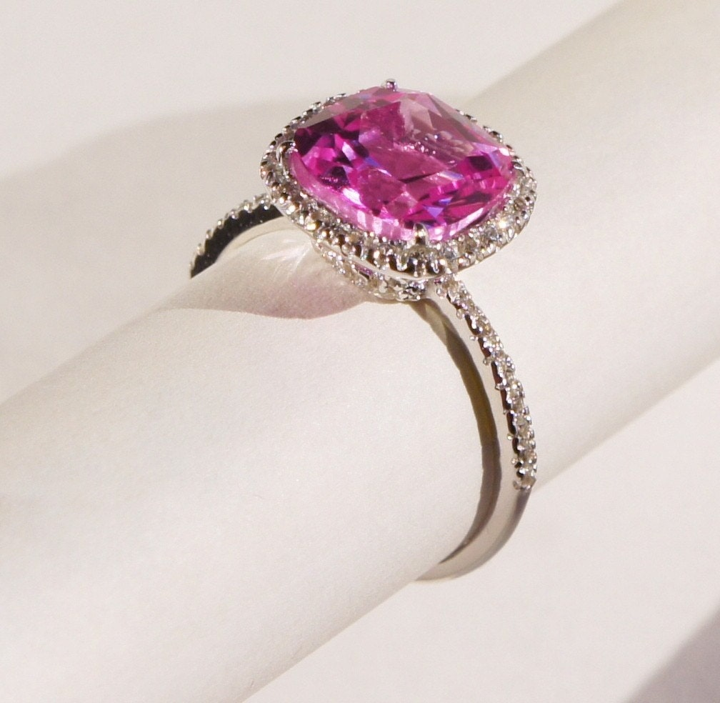 Brilliant pink cushion cut ruby halo ring micropave by halorings