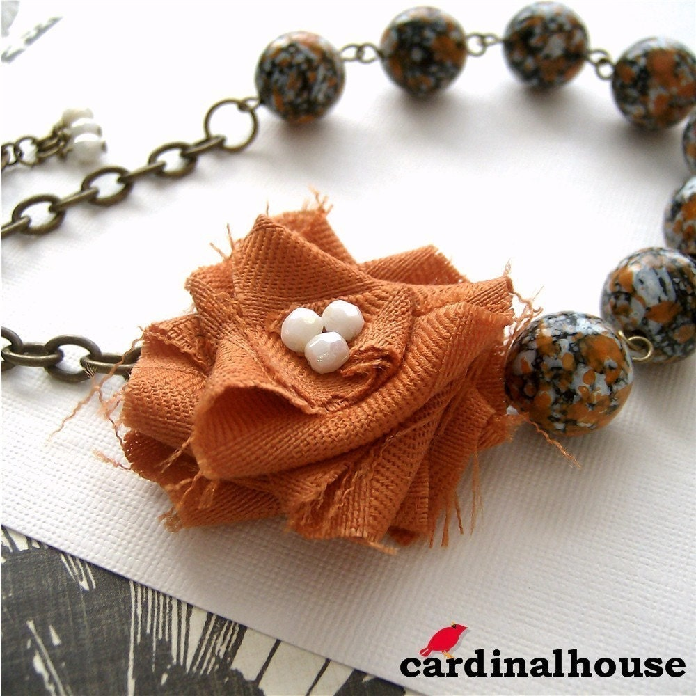 Rosa. Statement necklace with orange and white fabric flower and vintage speckled beads