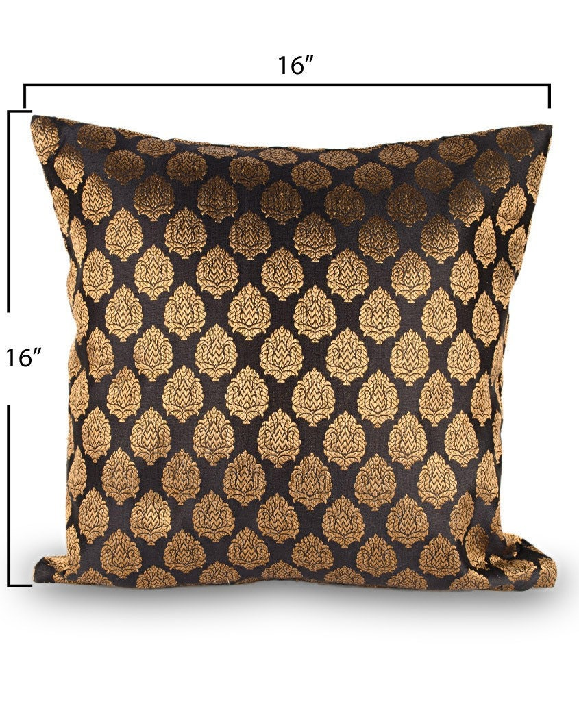 Traditional black brocade cushion cover with small golden motifs