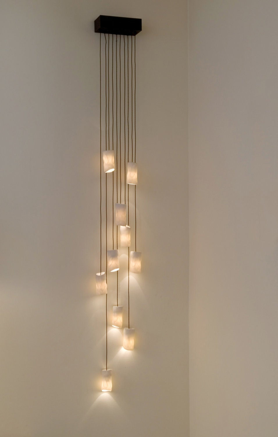 Amorphous cylinder wall sconce