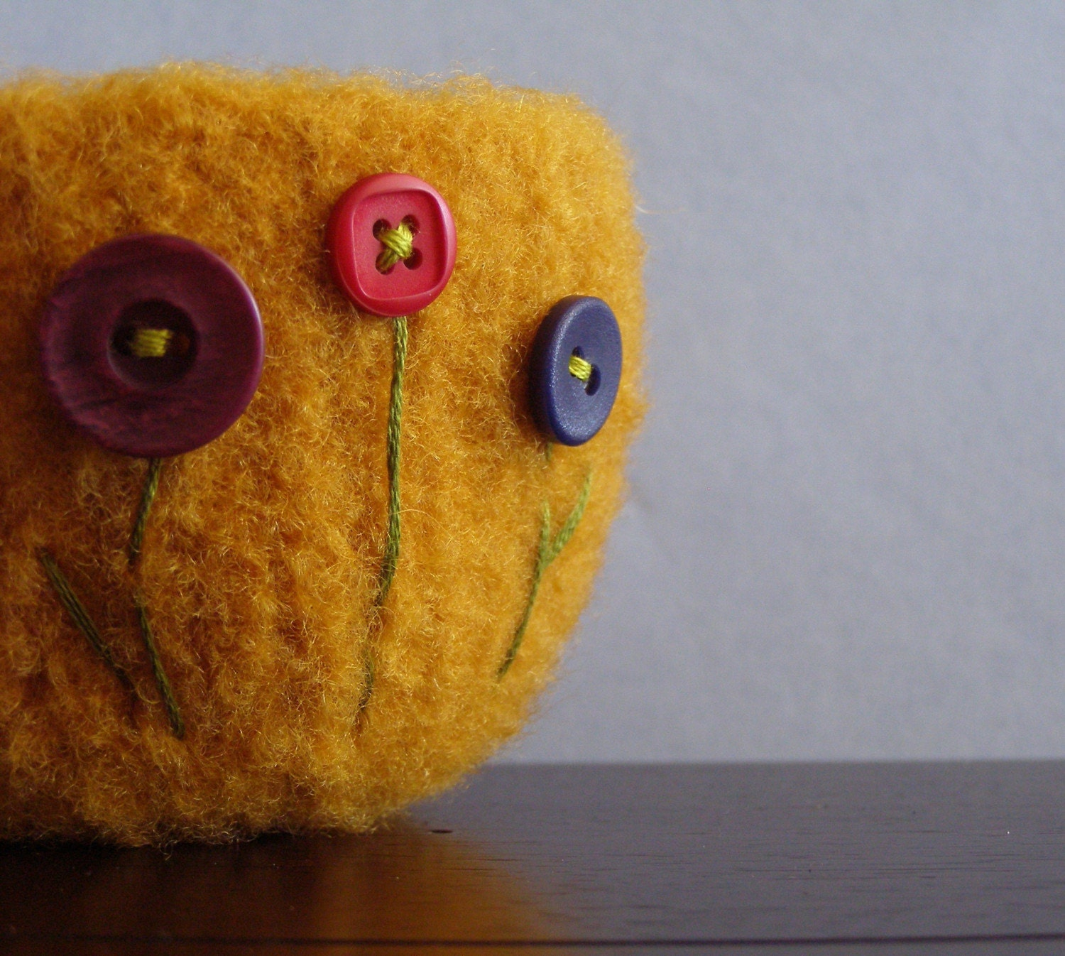 fuzzy orange gold felted wool bowl with three button flowers