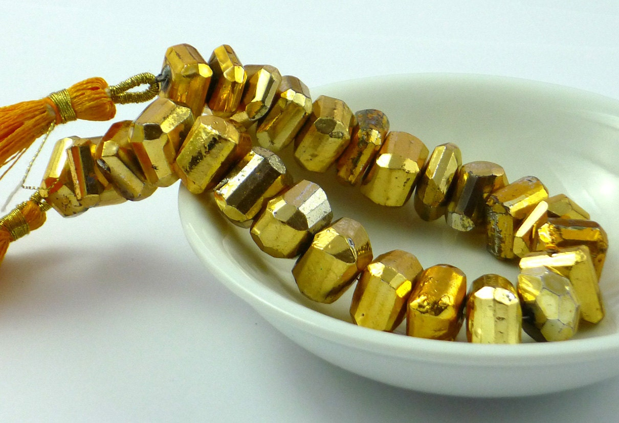 Gold coated faceted pyrite nuggets 10-12mm 1/4 strand