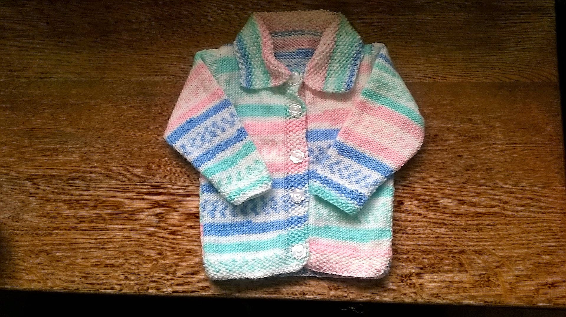 Girls Knitted Jacket 918 months size with matching Hat