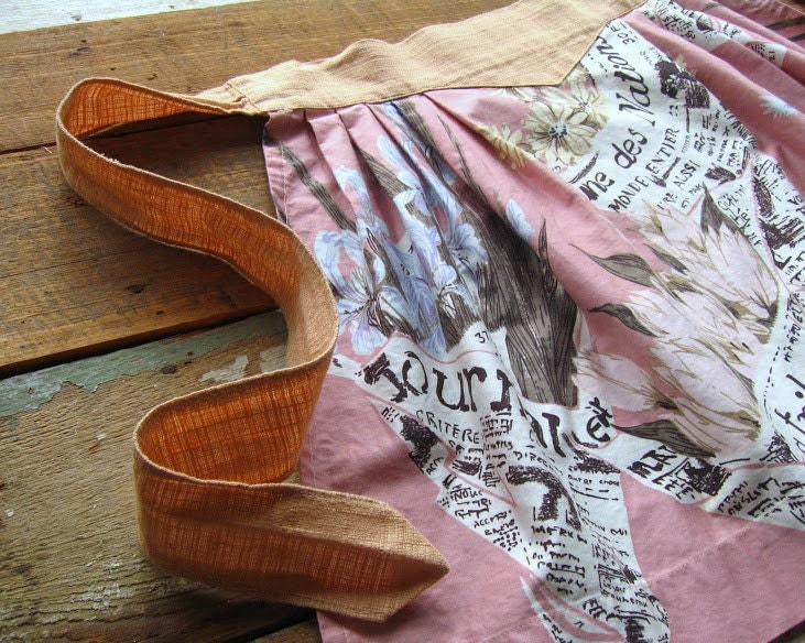 vintage french newspaper fabric apron