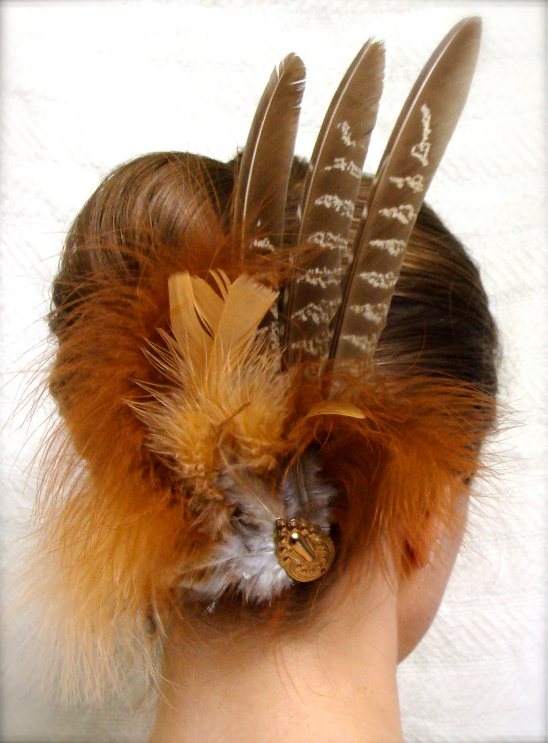 fall colored feather head piece in copper, rust, and peach colors and a vintage upcycled gold accent