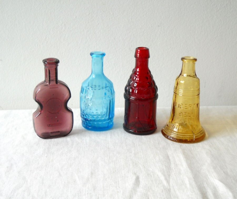 4 miniature colored glass bottles figural by
