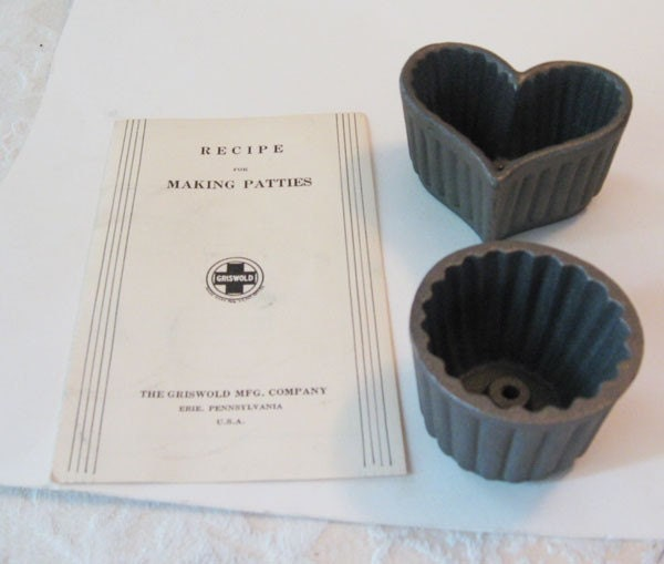 2 cast iron patty molds made by the
