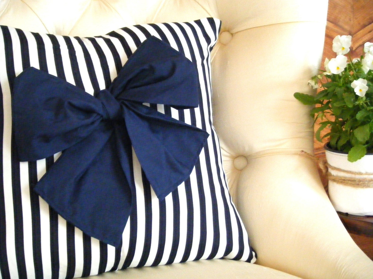 Preppy Love Cushion - Navy blue and white striped cushion with large navy blue bow