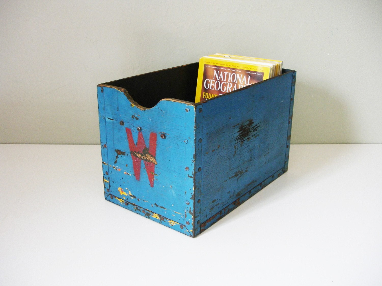 blue wooden box with red W and yellow back