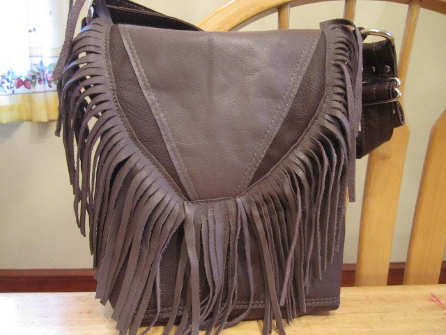 Dark Plum and lavender gray leather bag with fringe on flap and adjustable shoulder/arm strap