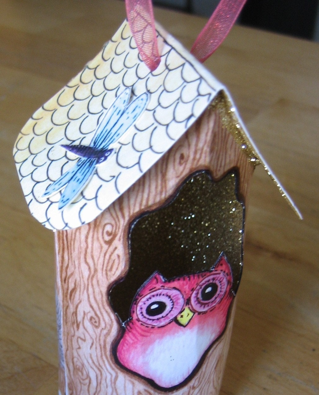 <br />hollow tree with owl ,bat and squirrel limited edition ornament<br />