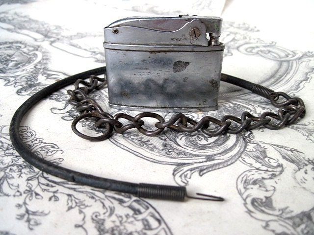 Flintlock.  Mens Antique Lighter Choker.