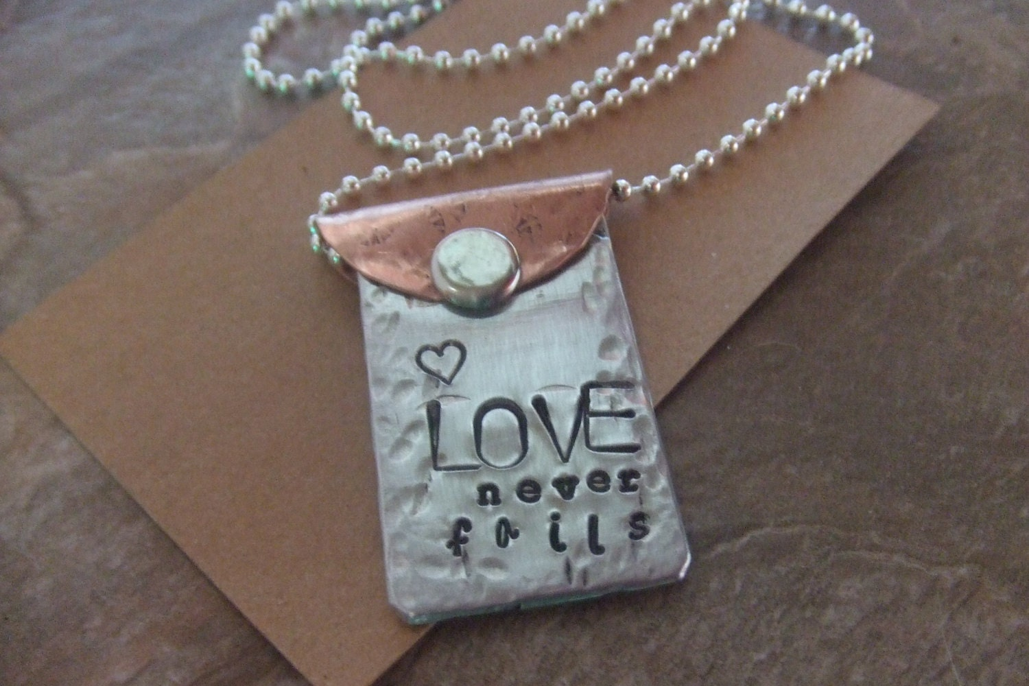 Handstamped Copper and Silver Necklace - Love Never Fails - Mixed Metal - BraceletsbyLinda