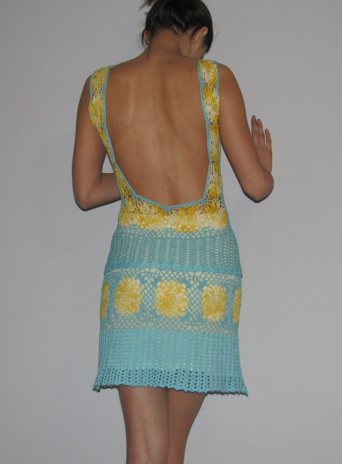 A soft blue and yellow hand crochet dress