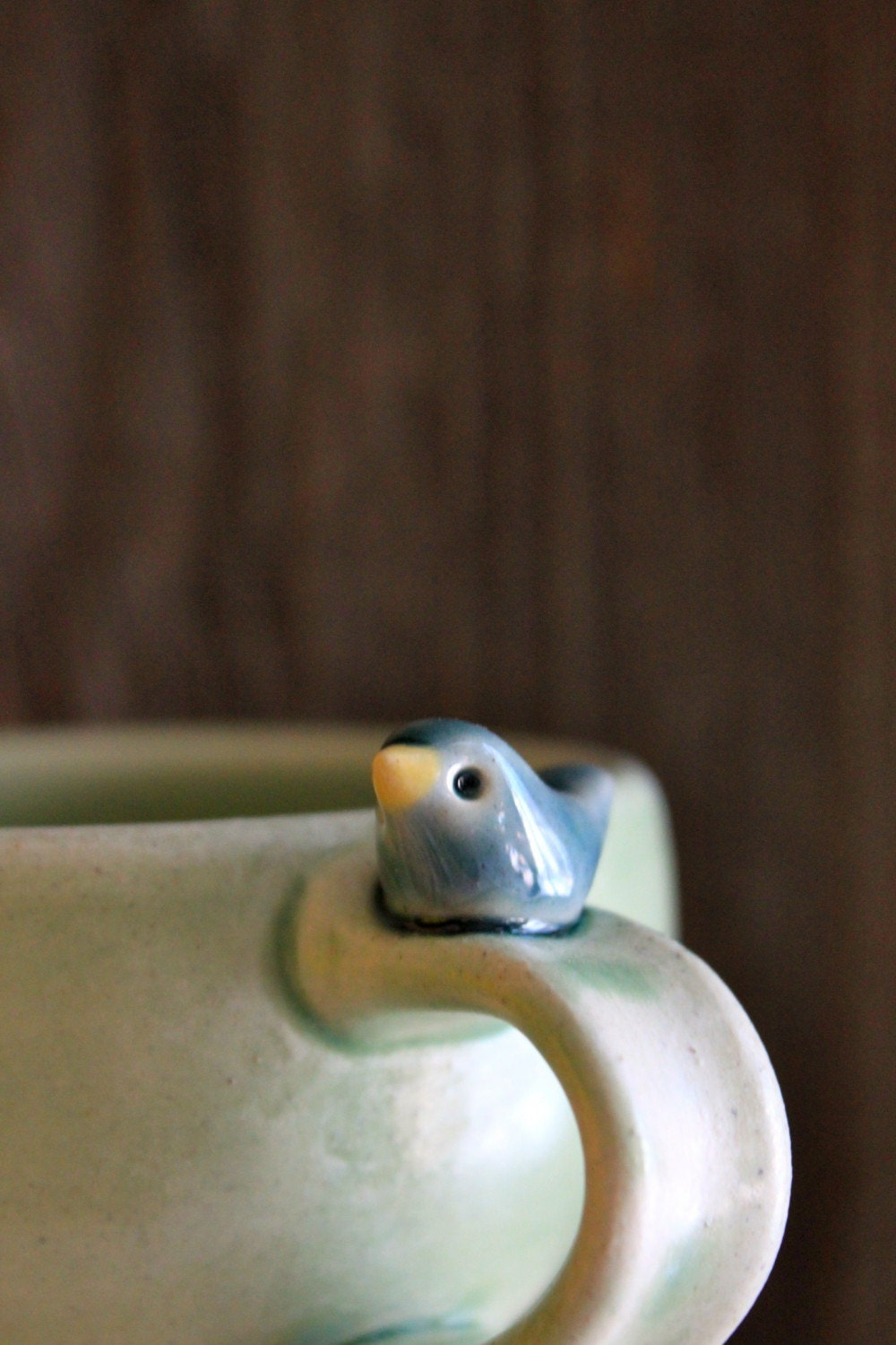 Sweet Little Tiny Blue Bird on a Pale Green Cup