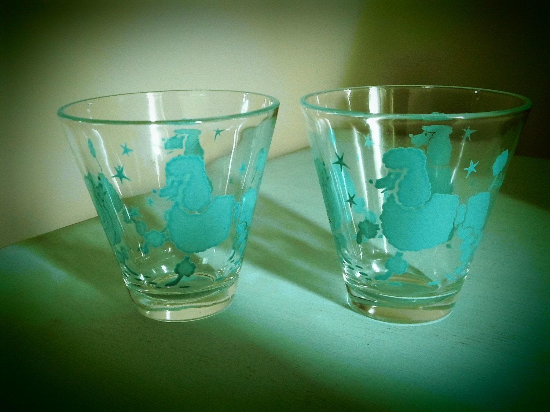 Vintage set of turquoise poodle shot glasses