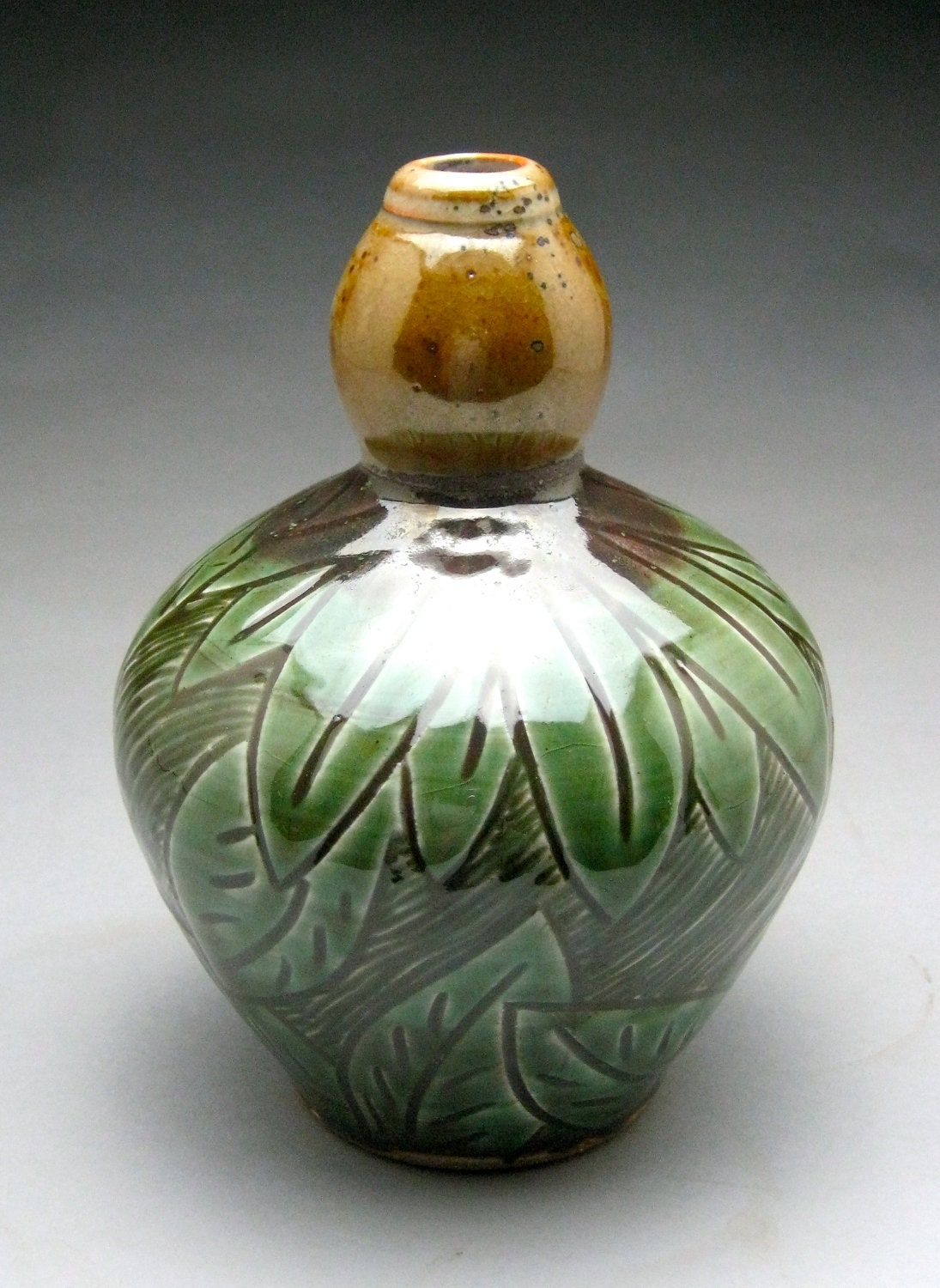 Green Stoneware Bottle with Carved Flowers and Leaves