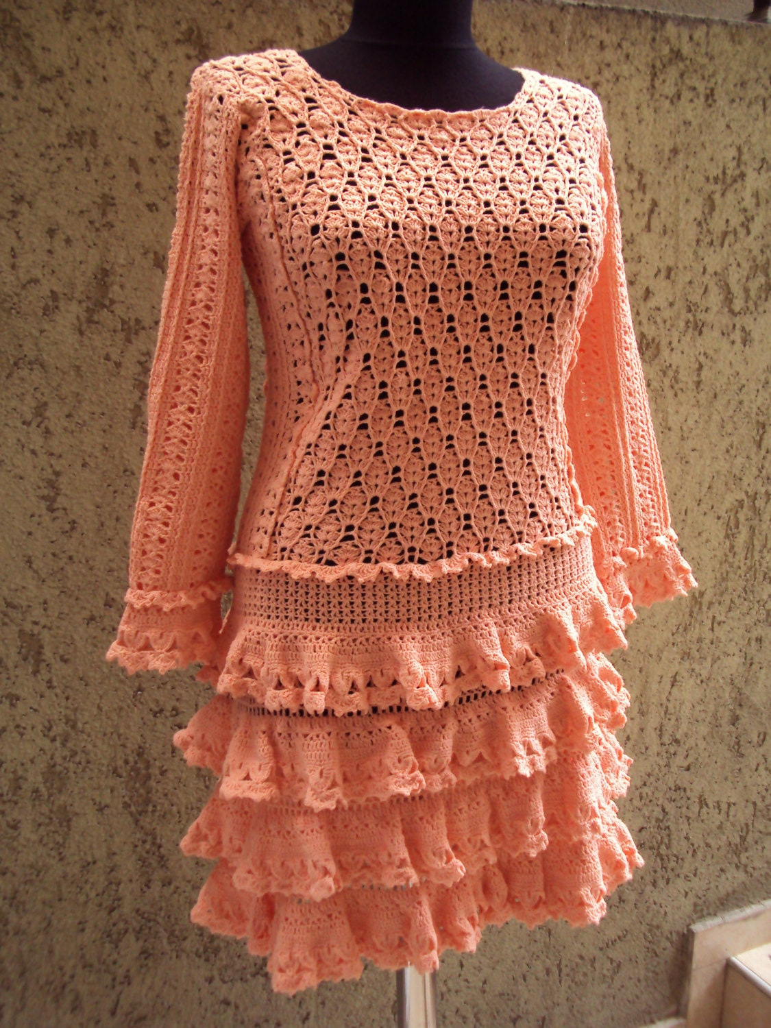 Crochet women dress in light orange colour good for everyday and official moments