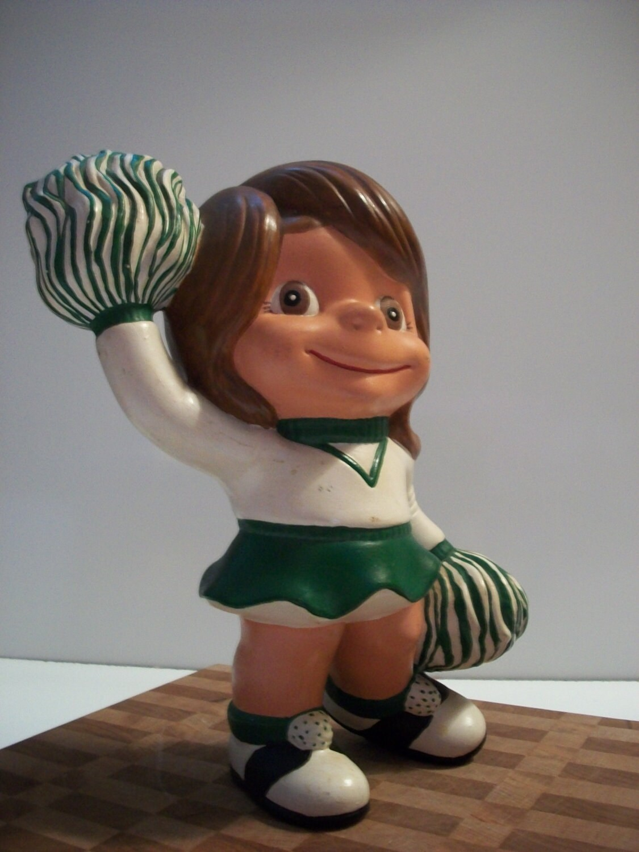 Vintage 1970s Atlantic Mold Ceramic Cheerleader Figurine Green and White - MarciesNook