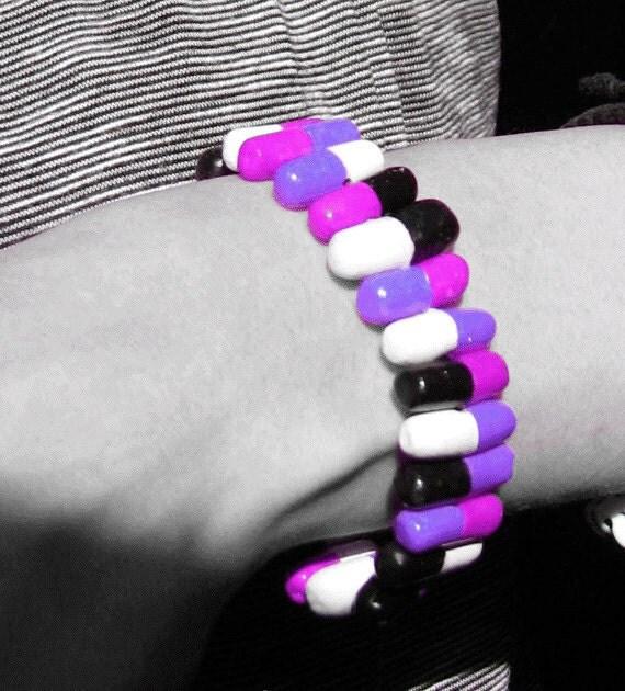 Purple and Black Capsule Pill