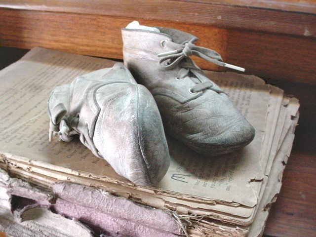 These Vintage Baby Shoes have seen some walkin. Bone gray leather the color of old antique paper
