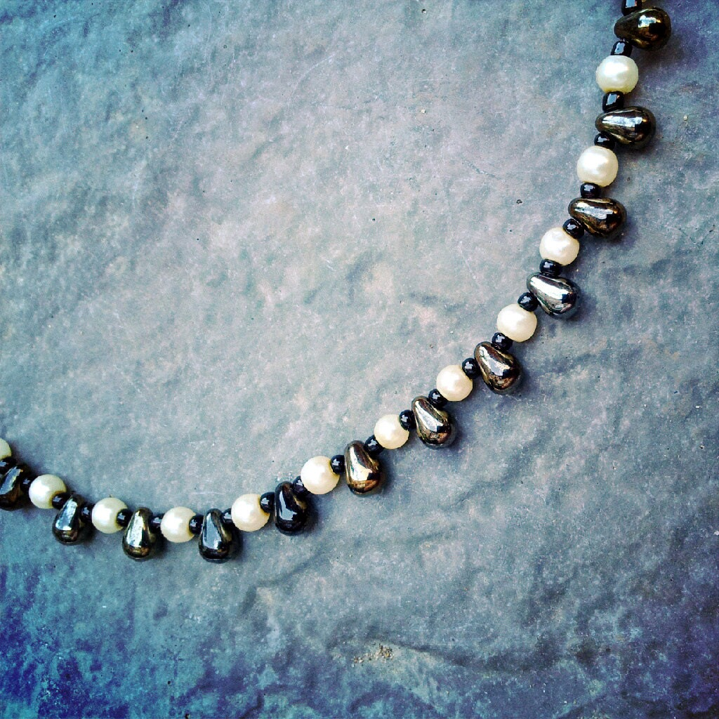 Black, cream and brown glass beaded necklace