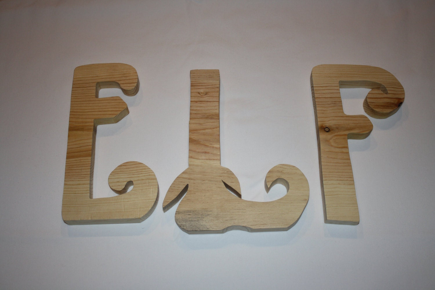 ELF unfinished wood letters sure to get you into the Christmas spirit