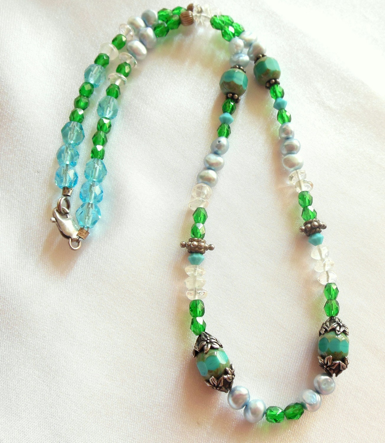 green and blue beaded necklace marked 925 by vjsejewelsofhope