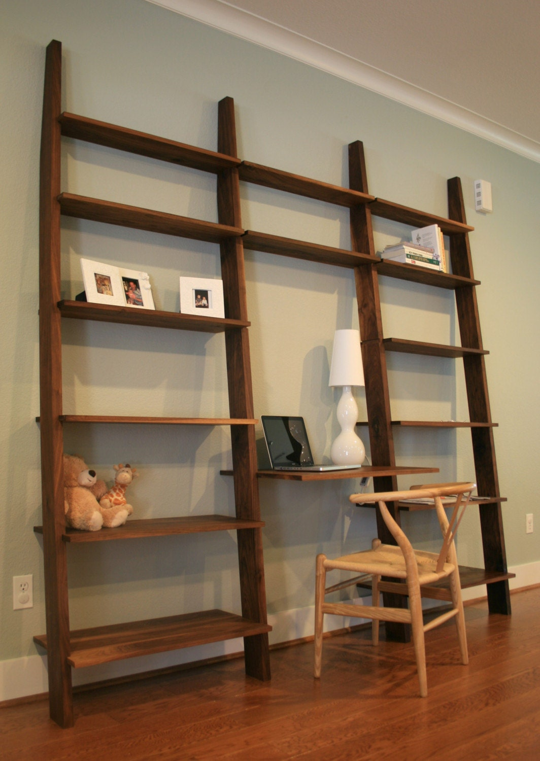 the leaning bookshelf with desk they do offer the bookshelf without the desk too