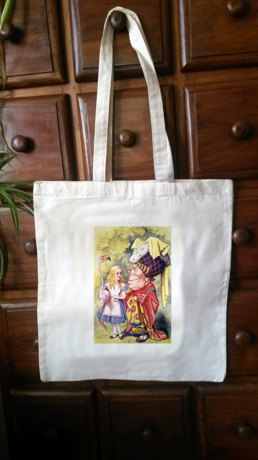 One CreamWhite Cotton Tote with an original illustration taken from the first edition of CS Lewiss Alice in Wonderland (Bag05)