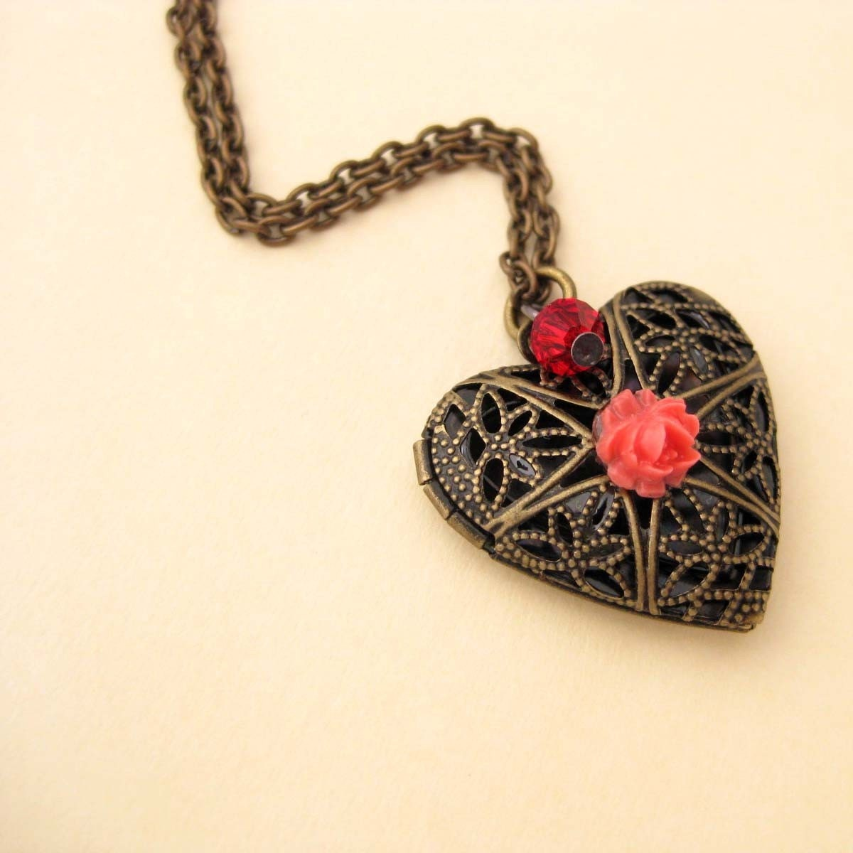 April Heart Locket, antique brass, coral flower, crystal