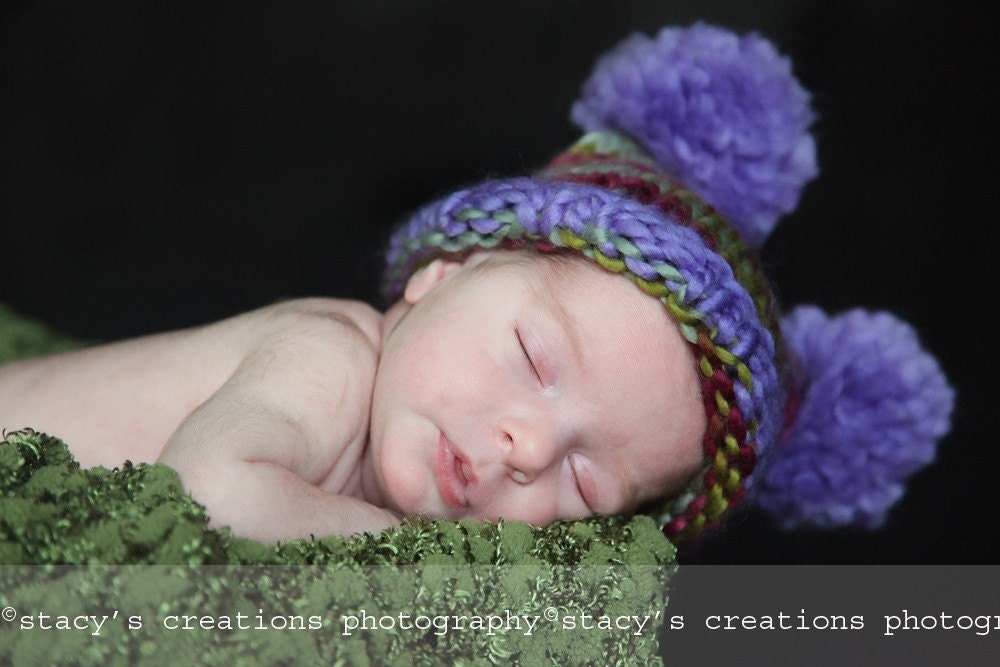 Funny square hat of a melange yarn with 2 pompoms. Sizes 0 - 12 month. Great for a gift or for a photo prop. Item 058 Lavender and herbs