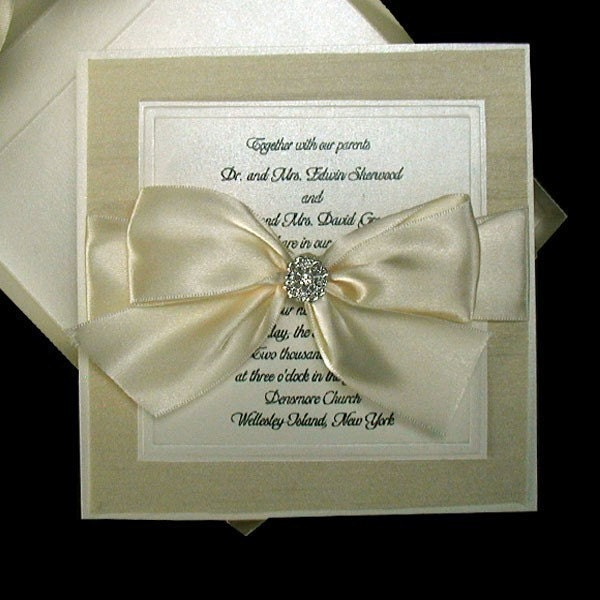 100 Boxed Couture Wedding Invitations. Never seen before features, Shantung fabric layer and guests names printed on ribbon. Your guests will love this detail.