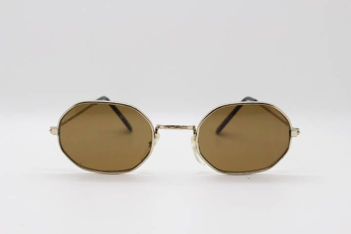 90s octagonal vintage sunglasses. Original NOS gold metal frame with brown lenses. NWOT. Dead stock. John Lennon. Steampunk.