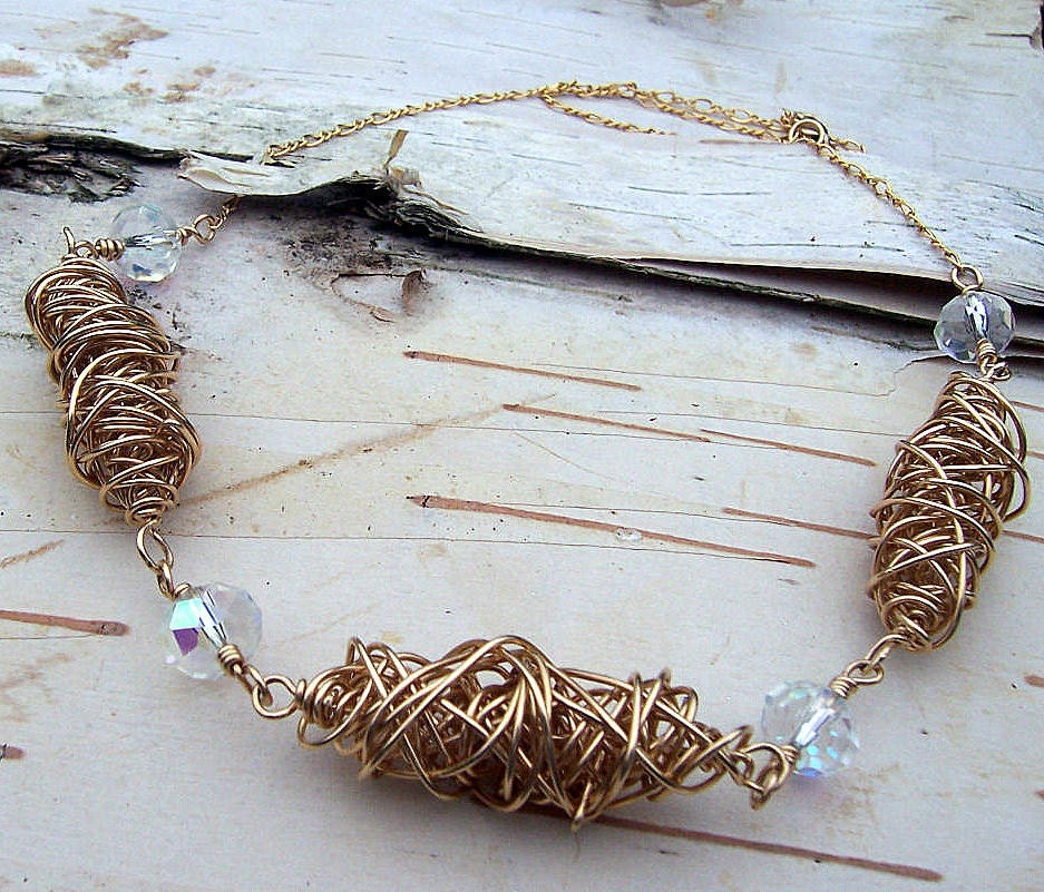 Gold and crystal twisted bead necklace