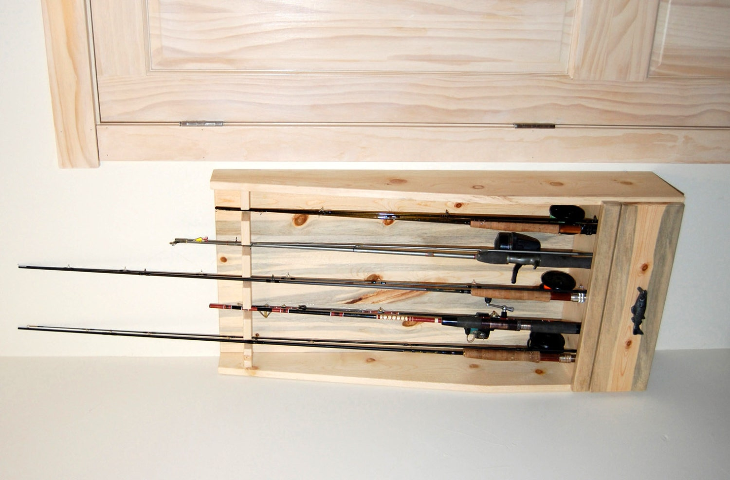 Fishing rod rack built of beetle killed pine by for Diy fishing pole rack