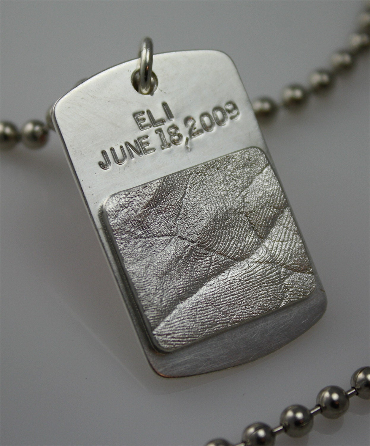 Soldiers' dog tag with son/daughters hand/foot impression in sterling