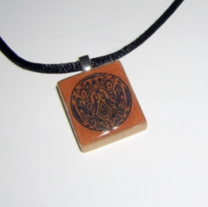 NEW MOON Quileute/Werewolf Tattoo Scrabble Tile Pendant. From aripagdesigns
