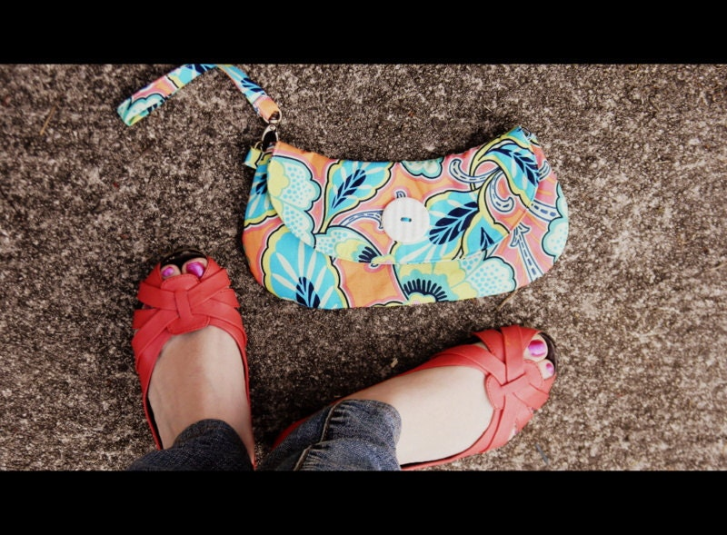 Bright orange floral wristlet clutch