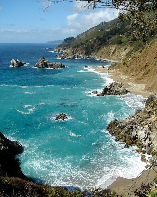 Turquoise waters and cliffs line the coast at Big Sur, California.