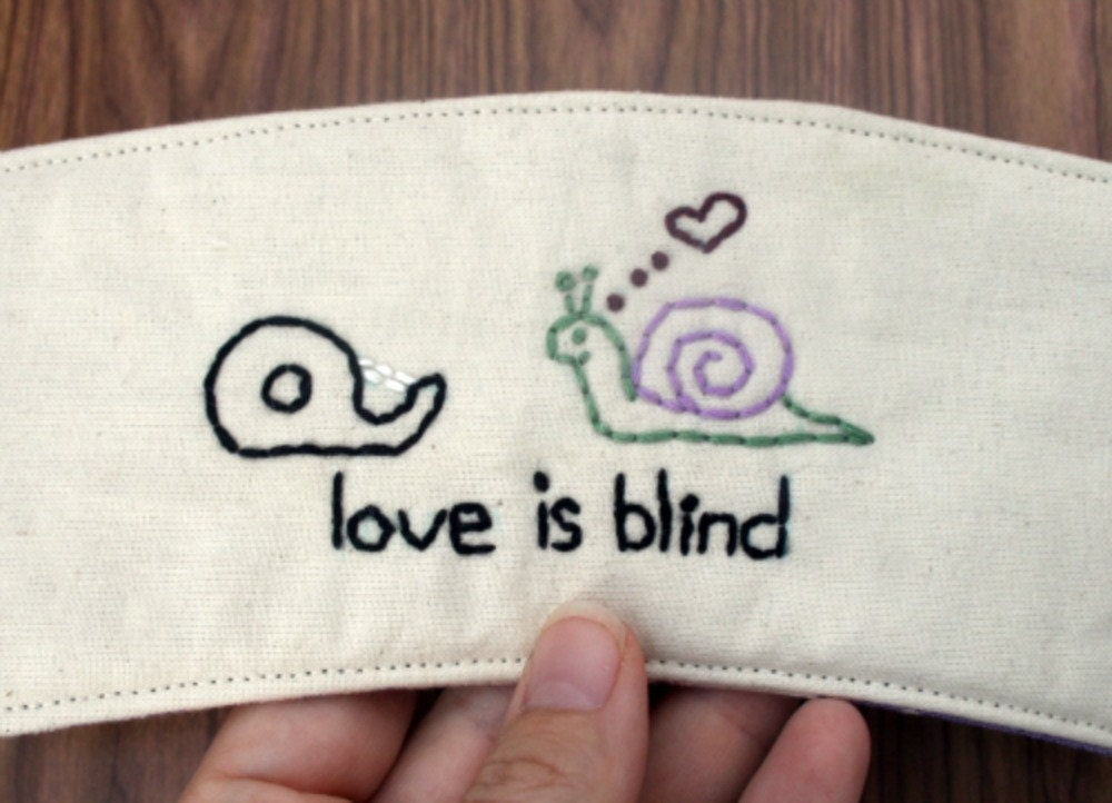 Love is blind cup cozy.